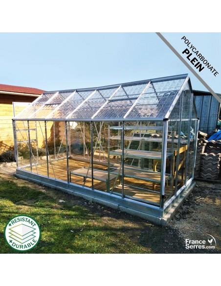 Serre de jardin 7,10m² avec polycarbonate plein transparent et polycarbonate plein effet tuile transparente sur le toit